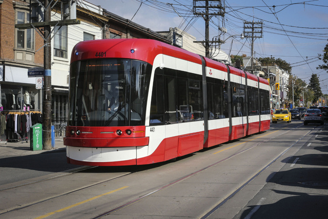 TORONTO, ON- OCTOBER 16 The TTC is training operators on one of the new streetcars seen here traveling west on Queen St at Wheeler Ave in the Beaches area of Toronto, October 16, 2014. David Cooper/Toronto Star